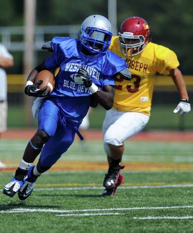 Irvin Philips carries the ball for West Haven during their scrimmage with St. Joseph High School Saturday, August 25, 2012 at St. Joseph in Trumbull, Conn. Photo: Autumn Driscoll / Connecticut Post