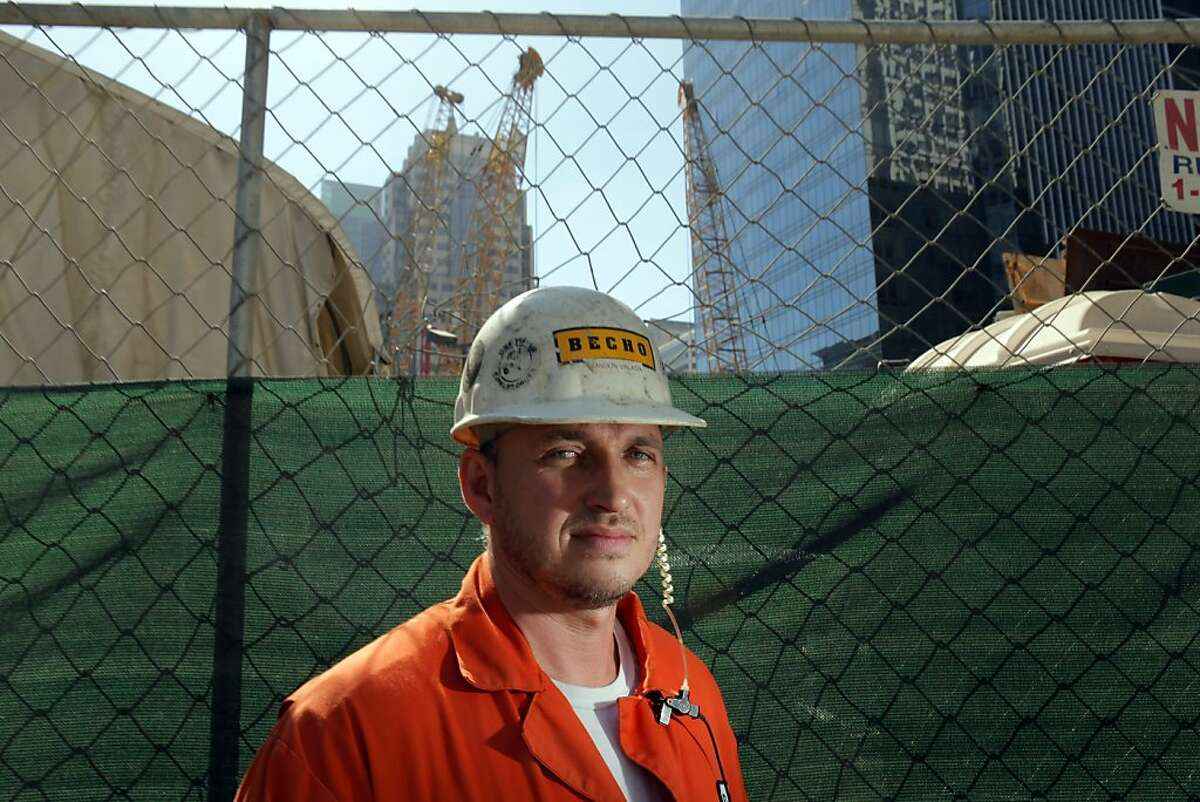 Crane operator Brandon Valasik poses on Wednesday, September 12, 2012, in San Francisco, Calif., at the site of the Transbay Terminal where he unearthed parts of the remains of a wooly mammoth.