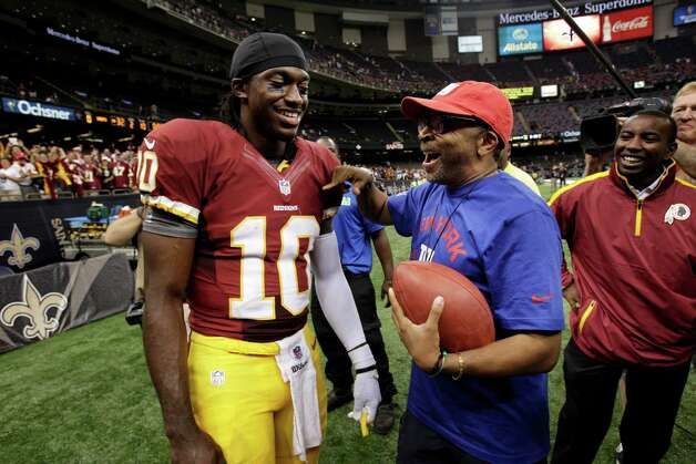 Washington Redskins quarterback Robert Griffin III (10) shares a laugh with director Spike Lee after an NFL football game at the Mercedes-Benz Superdome in New Orleans, Sunday, Sept. 9, 2012. Photo: Matthew Hinton, Associated Press / FR170690 AP