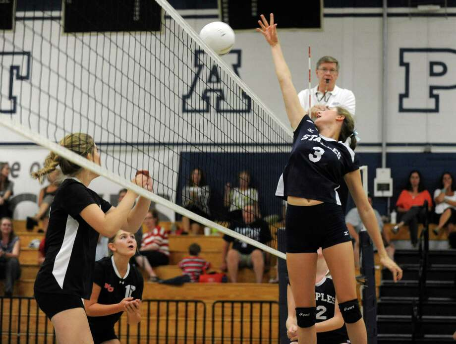 Staples' Cheyenne Haslett returns the ball to New Canaan during the girls volleyball season opener at Staples High School Wednesday, Sept. 12, 2012. Photo: Autumn Driscoll / Connecticut Post