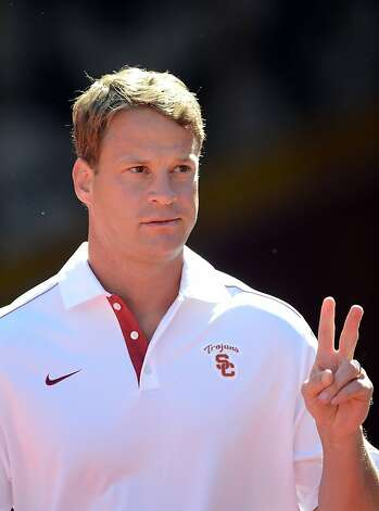 LOS ANGELES, CA - SEPTEMBER 01:  Head Coach Lane Kiffin of the USC Trojans greets fans with the Trojan symbol before the game against the Hawaii Warriors at Los Angeles Coliseum on September 1, 2012 in Los Angeles, California.  (Photo by Harry How/Getty Images) Photo: Harry How, Getty Images