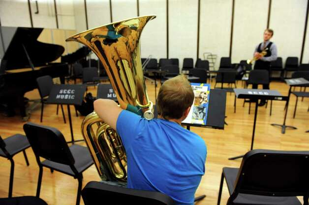 Music students Petey Pezzulo, 18, left, and Ben Carlson, 19, wait for class to start in the improved band room of the Music School on Wednesday, Sept. 12, 2012, at Schenectady County Community College in Schenectady, N.Y. The band room has improvements to the floor, ceiling and lights. (Cindy Schultz / Times Union) Photo: Cindy Schultz / 00019226A
