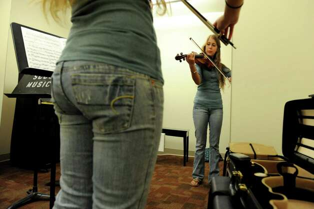 Violin major Anna Gugliuzza, 18, plays in one of the new practice rooms of the Music School on Wednesday, Sept. 12, 2012, at Schenectady County Community College in Schenectady, N.Y. (Cindy Schultz / Times Union) Photo: Cindy Schultz / 00019226A
