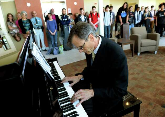 "Instructor Mark Evans performs Claude Debussy's ""Gradus ad Parnassum"" in the new lobby of the Music School on Wednesday, Sept. 12, 2012, at Schenectady County Community College in Schenectady, N.Y. (Cindy Schultz / Times Union) Photo: Cindy Schultz / 00019226A"
