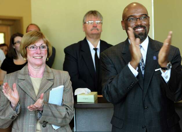 Judy Dagostino, chair of the Schenectady County Legislature, left, and Quintin Bullock, school president, applaud performances in the new lobby of the Music School on Wednesday, Sept. 12, 2012, at Schenectady County Community College in Schenectady, N.Y. (Cindy Schultz / Times Union) Photo: Cindy Schultz / 00019226A