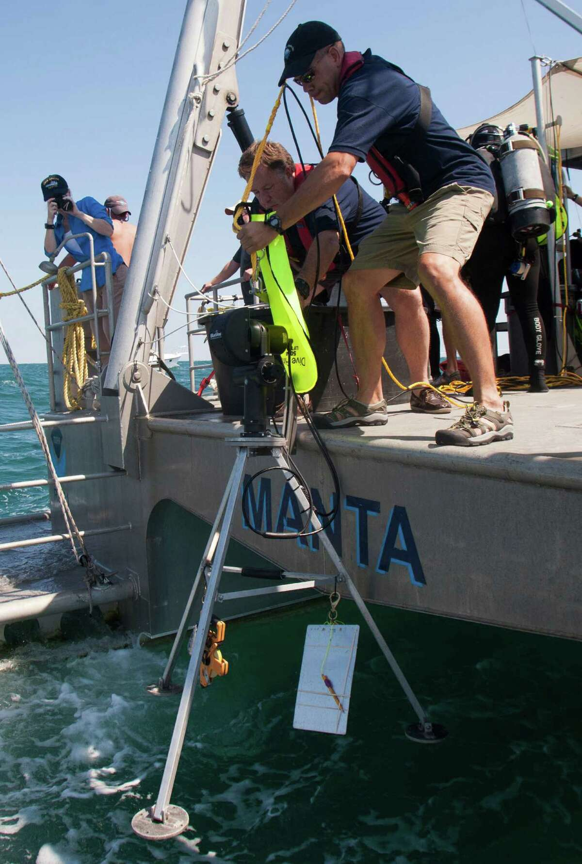 James Glaeser deploys sonar equipment from a research vessel to do acoustic scans of the USS Hatteras. The only Union vessel sunk in the Gulf of Mexico during the Civil War, it rests beneath 57 feet of water.