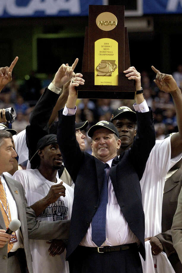 FILE - In this April 5, 2004, file photo, Connecticut head coach Jim Calhoun holds the trophy after his team defeated Georgia Tech 82-73 to win the NCAA Final Four college championship game in San Antonio. Calhoun is expected to announce his retirement on Thursday, Sept. 13, 2012, according to a person familiar with the situation. (AP Photo/Eric Gay, File) Photo: Eric Gay, Associated Press / AP