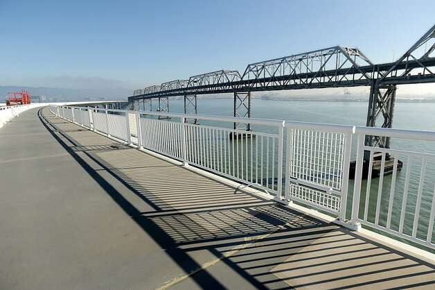 A pedestrian and bike lane stretches along the eastern span of the Bay Bridge but not the western span - yet. Photo: Noah Berger, Special To The Chronicle