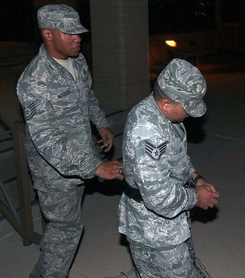 Sept. 12, 2012: Staff Sgt. Kwinton Estacio is led away from the 37th Training Wing Headquarters after sentencing in his trial at Joint Base San Antonio-Lackland. He was sentenced to one year in prison after pleading guilty to charges of obstruction and having sex with a trainee in violation of Air Force conduct rules. Read more: Former Lackland trainer receives 1-year sentence Photo: Tom Reel, San Antonio Express-News / ©2012 San Antono Express-News