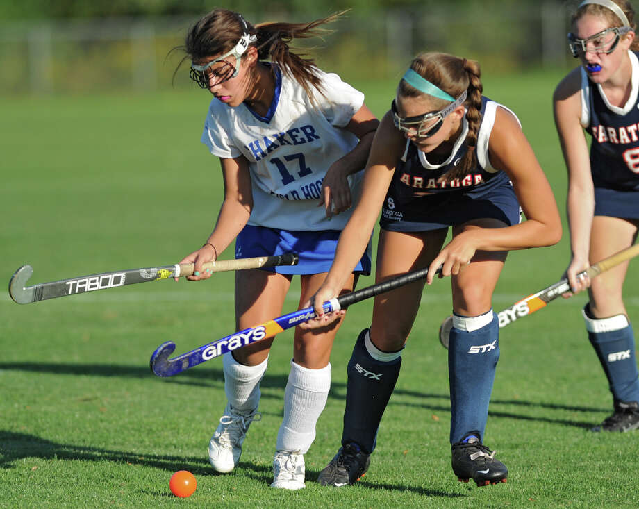 From left, Shaker's Victoria McAuley and Saratoga's Whitney Flansburg battle for the ball during a field hockey game Wednesday, Sept. 12, 2012 in Latham, N.Y. (Lori Van Buren / Times Union) Photo: Lori Van Buren