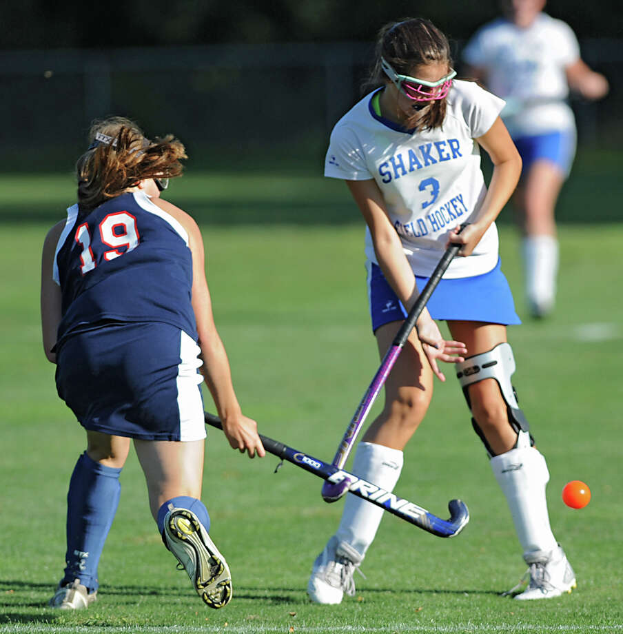 From left, Saratoga's Meg Roberts and Shaker's   Sara Zongrone battle for the ball during a field hockey game Wednesday, Sept. 12, 2012 in Latham, N.Y. (Lori Van Buren / Times Union) Photo: Lori Van Buren
