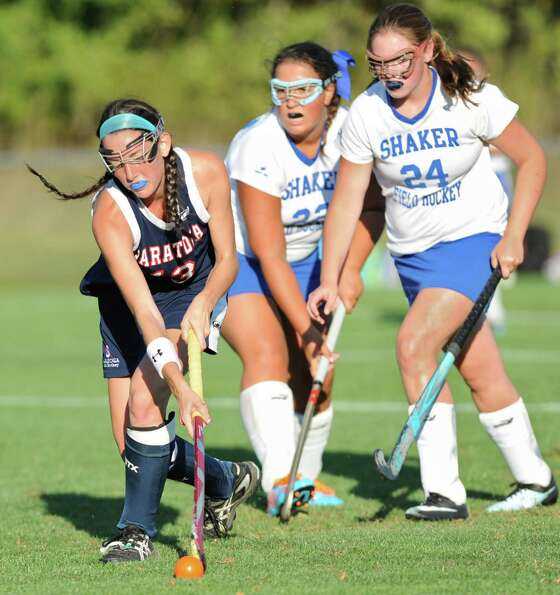 From left, Saratoga's Emily Petruccione keeps the ball away from Shaker's Madeline Laberge and Abby