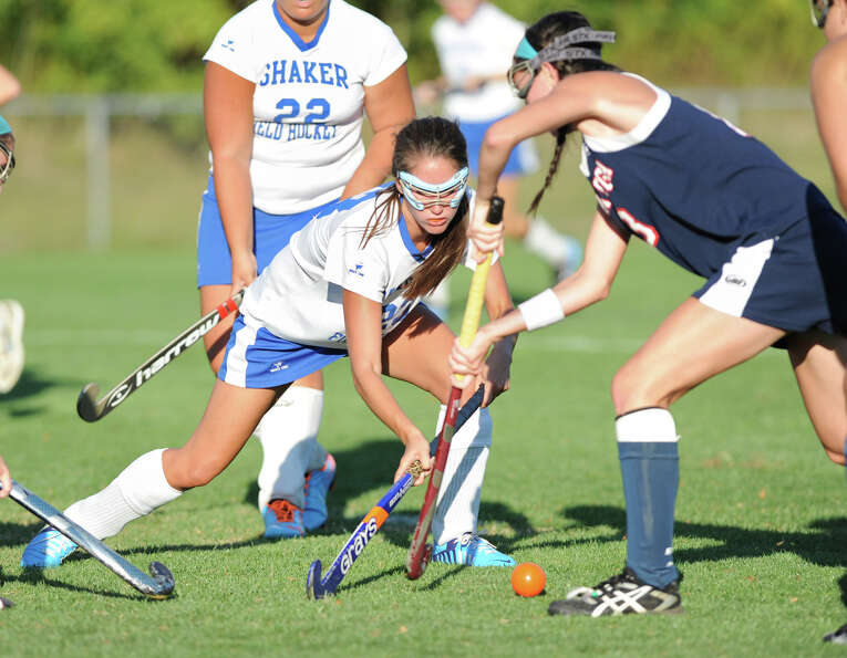 From left, Shaker's Katie Baltich and Saratoga's Emily Petruccione battle for the ball during a fiel