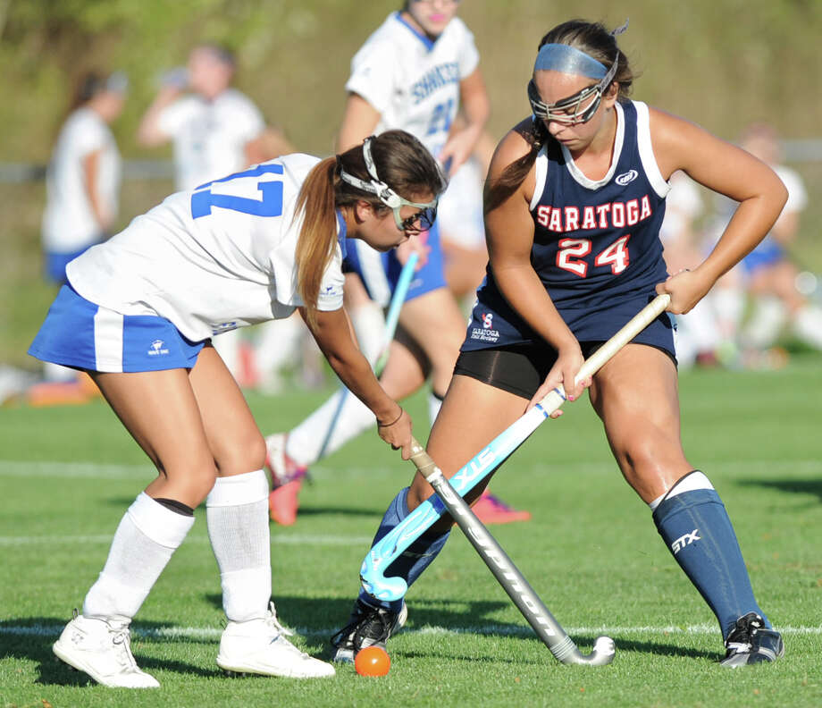 From left, Shaker's Victioria McAuley and Saratoga's Ann Mahoney battle for the ball during a field hockey game Wednesday, Sept. 12, 2012 in Latham, N.Y. (Lori Van Buren / Times Union) Photo: Lori Van Buren