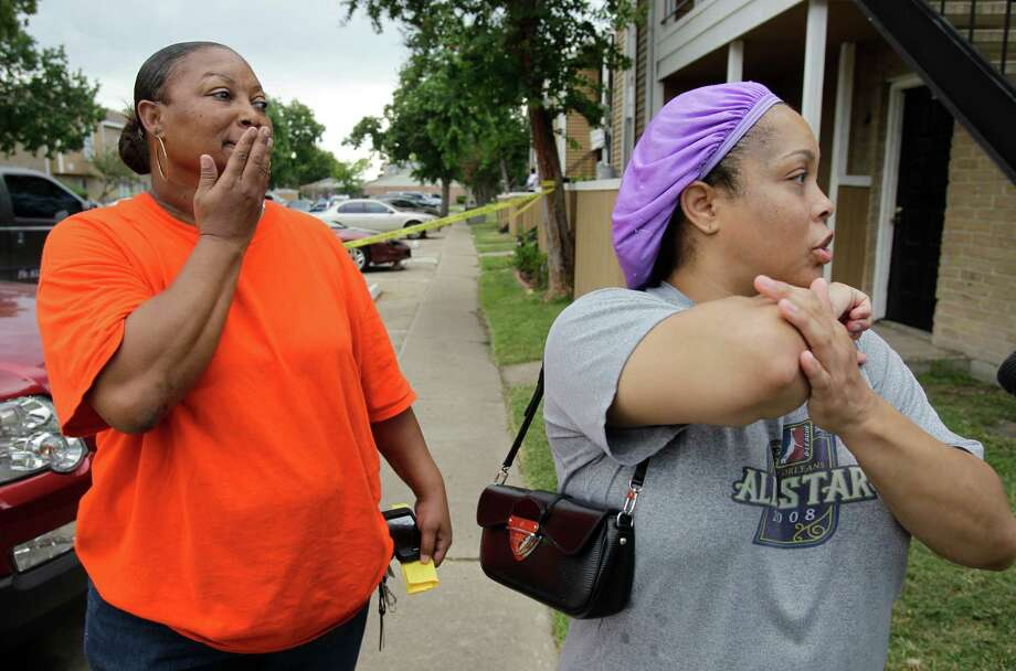 Sherry Davis, left, listens as Lathisha Redman describes how her son, Denzel Redman, 21, was shot in the arm while driving her car near The Mint at Dairy Ashford apartments Wednesday. The gunmen fled. Photo: Melissa Phillip / © 2012 Houston Chronicle