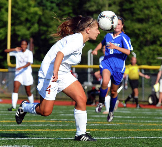 St. Joseph's #4 Alexandra Waizenegger heads the ball, during girls soccer action against Fairfield Ludlowe in Trumbull, Conn. on Tuesday September 12, 2012. Photo: Christian Abraham / Connecticut Post