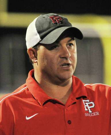 Head Coach for Fairfield Preparatory School, Ryan Lyddy, at their game against Newtown at the Newtown campus on Wednesday September 12, 2012. Photo: Lisa Weir / The News-Times Freelance