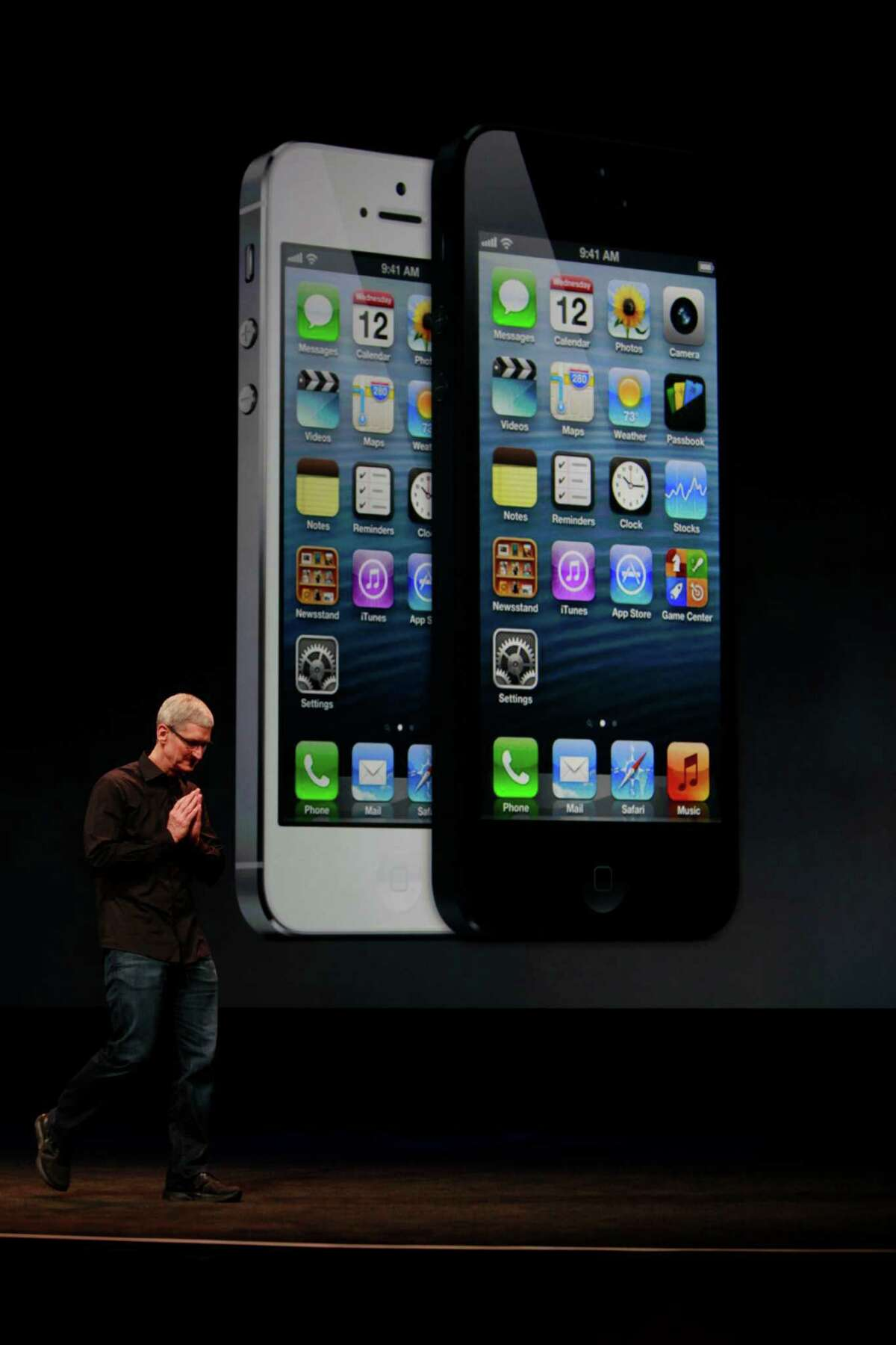 Apple CEO Tim Cook introduces the iPhone 5 on Wednesday in San Francisco. The new version features a larger screen and a faster network with a thinner, lighter design.