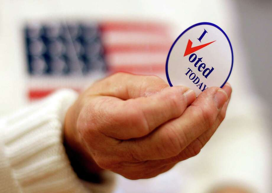 FILE - This Nov. 2, 2010 file photo shows a sticker handed out to a voter on Election Day, in Waterville, Maine.  Here's something most politicians can click the like button for: Facebook friends played a big role in getting hundreds of thousands of people to vote in 2010 who probably would have otherwise stayed home, a new scientific study claims. It provides scientific evidence showing the real world political power of social media. (AP Photo/Robert F. Bukaty, File) Photo: Robert F. Bukaty / AP