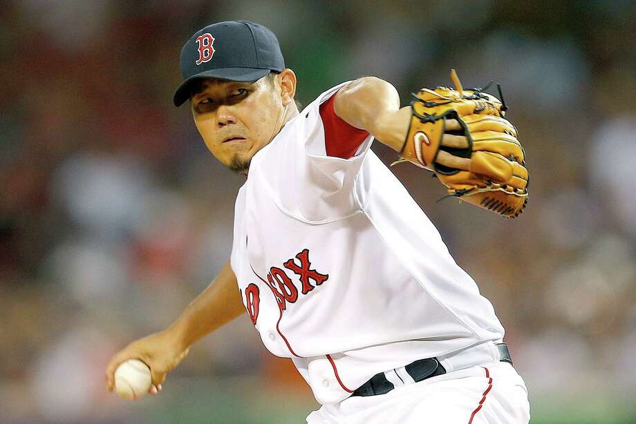 BOSTON, MA - SEPTEMBER 8:  Daisuke Matsuzaka #18 of the Boston Red Sox throws against the Toronto Blue Jays  in the first inning against the Boston Red Sox at Fenway Park on September 8, 2012 in Boston, Massachusetts.  (Photo by Jim Rogash/Getty Images) Photo: Jim Rogash / 2012 Getty Images