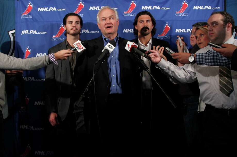 NHL Players Association executive director Donald Fehr, center, is joined by players Kevin Westgath, right, and George Parros after meeting with NHL officials. Photo: Mary Altaffer, Associated Press / AP