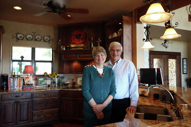 Barbara and Eldon Sheffer pose in the kitchen of their home in the Saddlewood Estates between Kerrville and Ingram, Texas, Tuesday, Sept. 11, 2012. Photo: Jerry Lara, San Antonio Express-News / © 2012 San Antonio Express-News