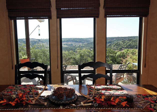The Hill Country is the main view from the dinning table at the Barbara and Eldon Sheffer home in the Saddlewood Estates near Kerrville, Texas, Tuesday, Sept. 11, 2012. Photo: Jerry Lara, San Antonio Express-News / © 2012 San Antonio Express-News