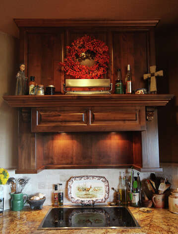 A wooden mantel is placed over the stovetop at the Barbara and Eldon Sheffer home in the Saddlewood Estates near Kerrville, Texas, Tuesday, Sept. 11, 2012. Photo: Jerry Lara, San Antonio Express-News / © 2012 San Antonio Express-News