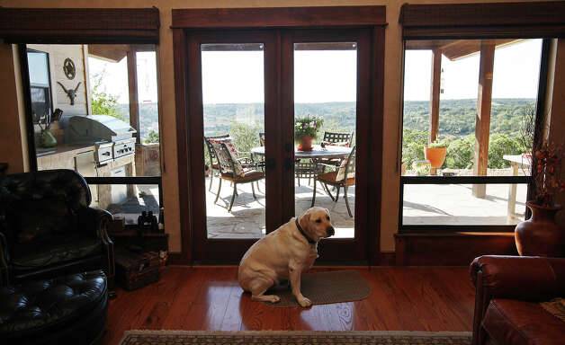 """Prince,"" a four-year-old yellow lab sits by the patio door at the Barbara and Eldon Sheffer home in the Saddlewood Estates near Kerrville, Texas, Tuesday, Sept. 11, 2012. Photo: Jerry Lara, San Antonio Express-News / © 2012 San Antonio Express-News"