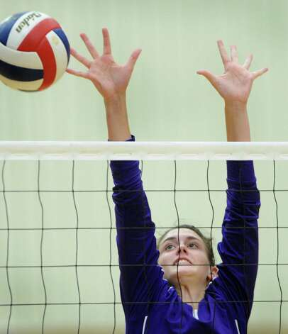 Lauren McQueen of Warren attempts a block during girls volleyball action against O'Connor at the Taylor Fieldhouse on Wednesday, Sept. 12, 2012. Photo: Billy Calzada, San Antonio Express-News / © San Antonio Express-News
