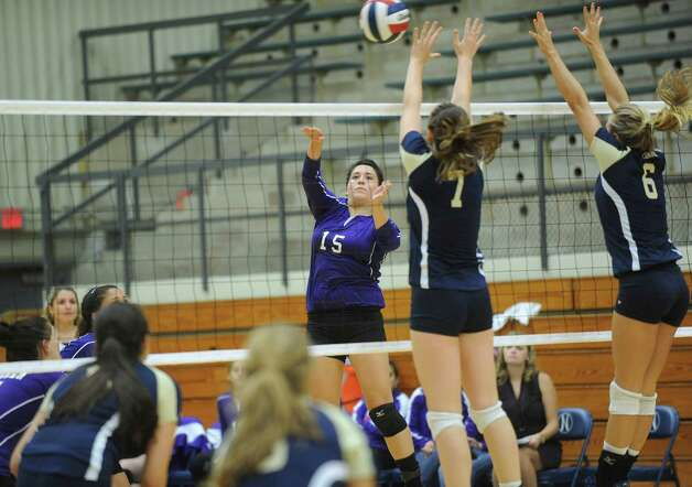 Shaina Garza (15) of Warren spikes against O'Connor's Laura Fox (7) and Brooke Burgess during girls volleyball action at the Taylor Fieldhouse on Wednesday, Sept. 12, 2012. Photo: Billy Calzada, San Antonio Express-News / © San Antonio Express-News