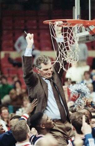 MARCH 11, 1990: Behind Smith, UConn upends top-seeded Syracuse 78-75, to win its first Big East title. (Gerald Herbert / AP Photo/Gerald Herbert)