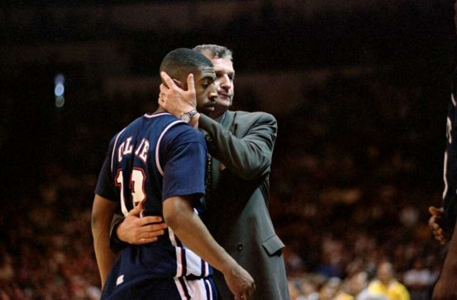 FEBRUARY 13, 1995: UConn, 19-1, reaches No. 1 in the national polls for the first time.MARCH 24 1995: Another shot at the Final Four falls short when top-seeded UCLA, the eventual national champion, emerges with an up-and-down 102-96 win in the Elite Eight.(Above, Calhoun hugs Kevin Ollie in the loss to UCLA) (Susan Ragan / AP Photo/Susan Ragan)