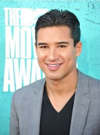 "Mario Lopez — A.C. Slater to ""Saved by the Bell"" fans — is 38, did a stint on ""Dancing With the Stars"" and is a correspondent on ""Extra."" (AFP/Getty Images)"