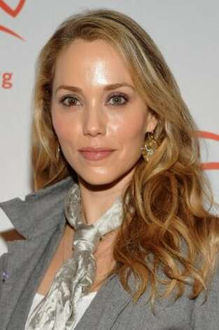 "Elizabeth Berkley, 40, played Jessie Spano. She's had many small roles in movies and TV roles shows over the years, but her most memorable post ""Bell"" role? As stripper Nomi Malone in ""Showgirls."" (Mike Coppola / 2011 Getty Images)"
