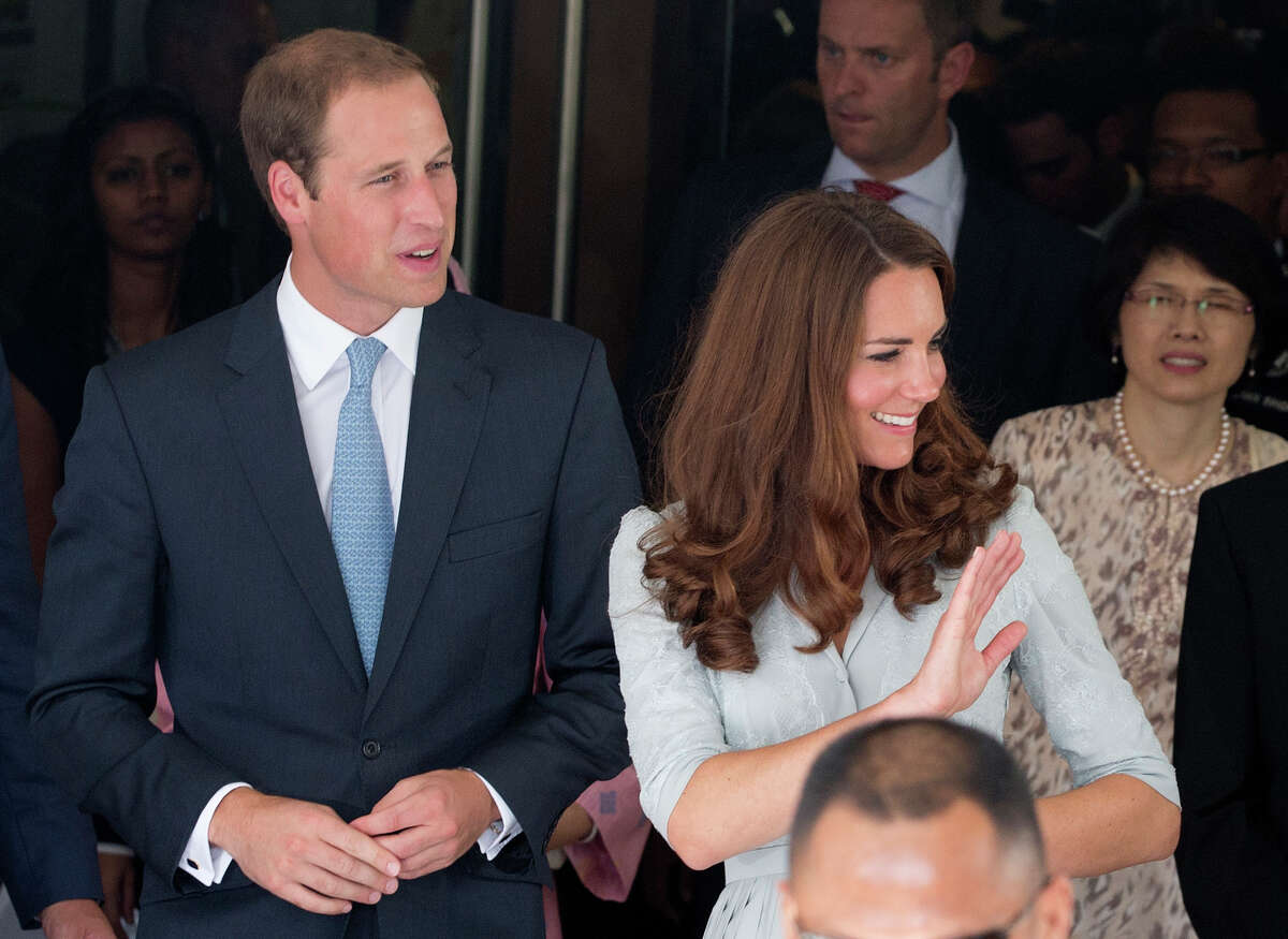Britain's Prince William and his wife Kate, the Duke and Duchess of Cambridge wave as they leave Hospis Malaysia in Kuala Lumpur, Malaysia, Thursday, Sept. 13, 2012. Prince William and Catherine are in Malaysia for a three-day visit as part of a tour to mark Queen Elizabeth II's Diamond Jubilee.