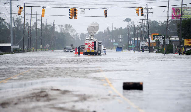 A CNN live truck braodcasts from a flooded intersection as water rises along Texas 62 in Orange County in the wake of Hurricane Ike in september, 2008. Enterprise file photo Photo: TAMMY MCKINLEY / Beaumont