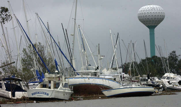 Just outside the Pleasure Island Marina entrance almost 200 boats were washed onto the main road by Hurricane Ike's storm surge. Enterprise file photo