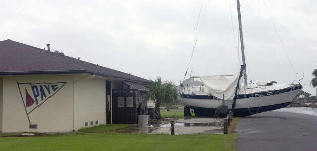The main building of the Port Arthur Yacht Club had a new neighbor in the parking lot after Hurricane Ike's storm surge moved a large number of the boats berthed there.  Enterprise file photo