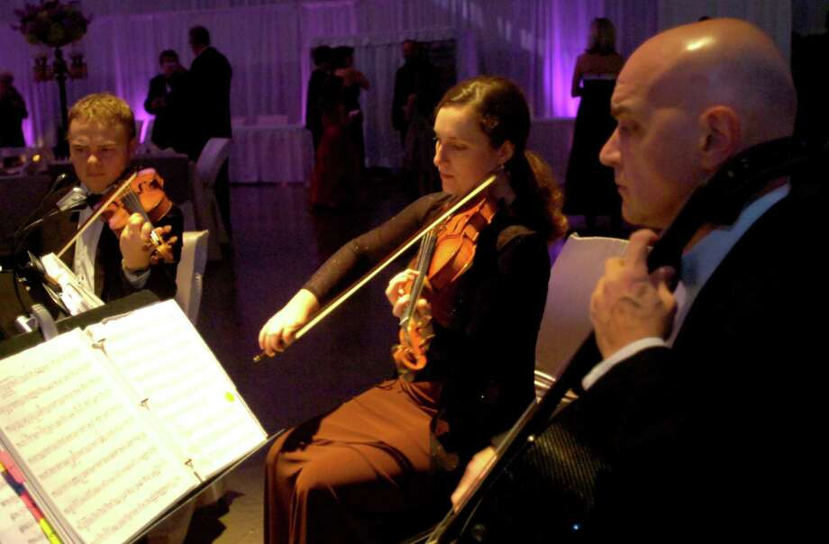 """A string quartet performs during the Symphony of Southeast Texas fundraiser,  """"A Night to Remember""""  Symphony Ball presented by the Symphony League of Beaumont at the Beaumont Civic Center in Beaumont, Saturday, February 4st, 2012. Tammy McKinley/The Enterprise Photo: TAMMY MCKINLEY"""