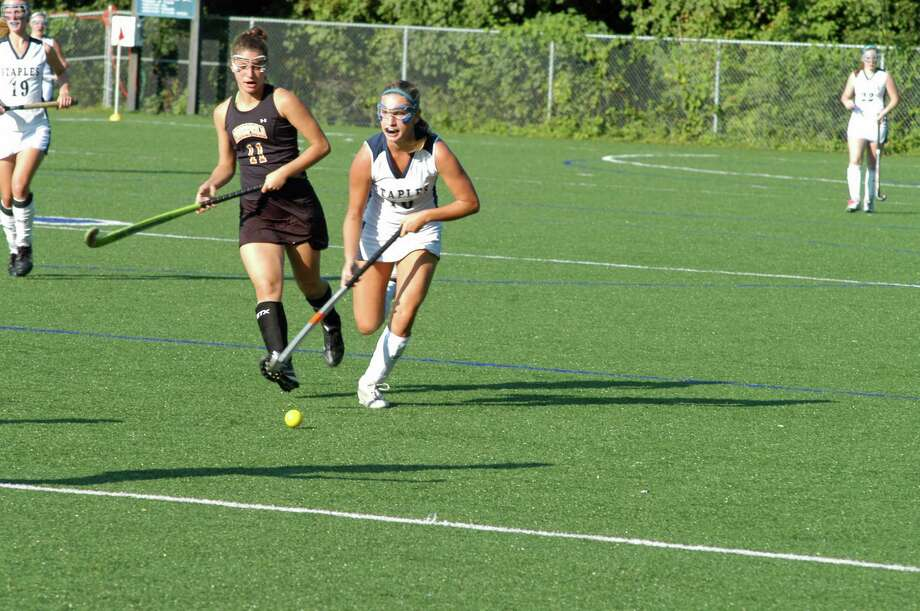 Staples' Jenna McNicholas pushes the ball up the field in a 4-0 win over Ridgefield on Wednesday Sept. 12, 2012 at Ginny Parker Field in Westport. Photo: Andy Hutchison