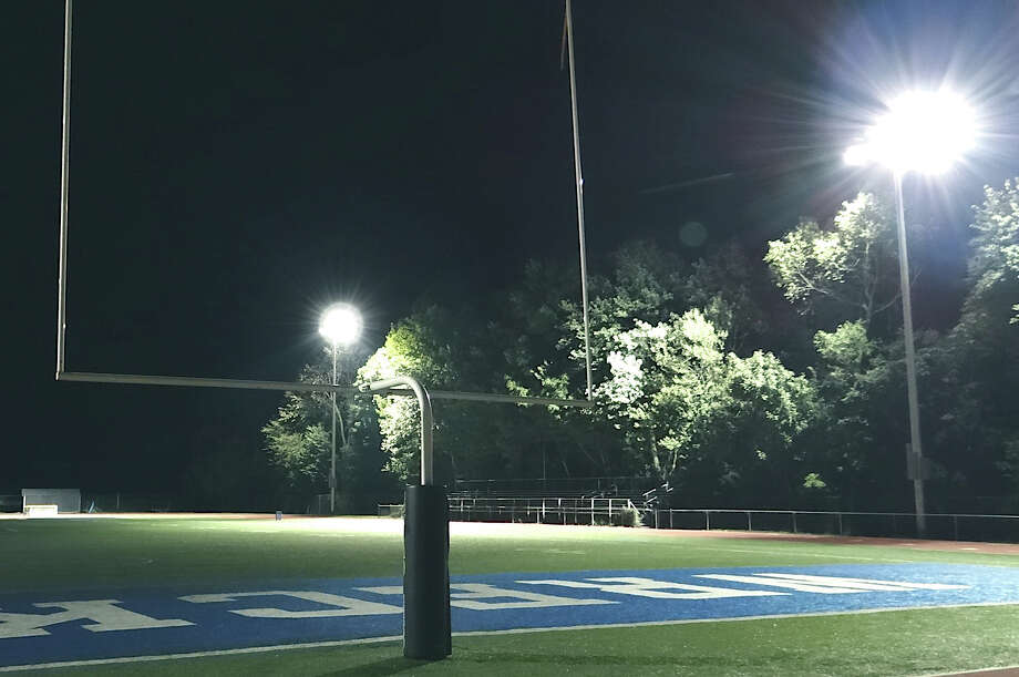 The new lights and sound system at Staples High School's stadium got a final test Wednesday night in advance of Friday night's season-opening football game. Photo: Mike Lauterborn / Westport News contributed