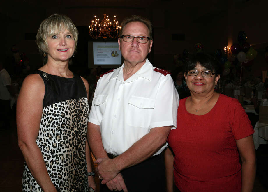 OTS/HEIDBRINK - Sponsor Marlene Richter, from left, Salvation Army Area Commander Captain Russell Czajkowski and event chairwoman Irma Mellon gather at the Grandparent's Day Celebration at St. Paul's Community Center on 9/6/2012. names checked photo by leland a. outz Photo: LELAND A. OUTZ, SPECIAL TO THE EXPRESS-NEWS / SAN ANTONIO EXPRESS-NEWS