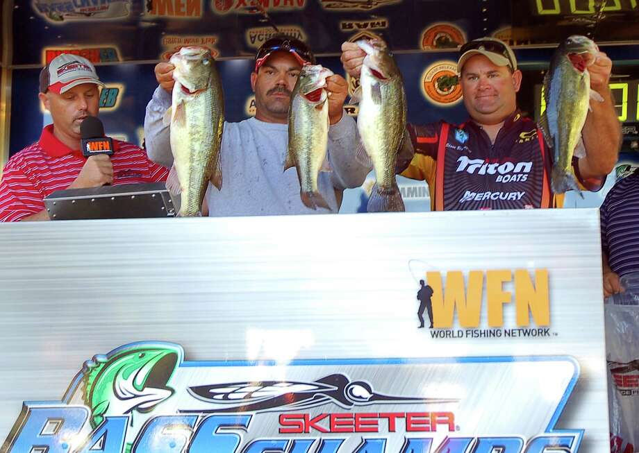 Shonn Blassingame & Cody Burdine hold up the best of their final catch that clenched the win at the 2012 Bass Champs Toledo Championship  Photo by Patty Lenderman / Lakecaster
