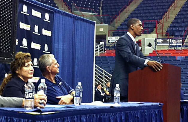 University of Connecticut President Susan Herbst and former UConn Coach Jim Calhoun listen as Kevin Ollie, who was named UConnâÄôs 18th head coach, addresses the media at Harry A.Gampel Pavilion in Storrs, Conn. on Thursday, Sept. 13, 2012. Photo: Autumn Driscoll / Connecticut Post