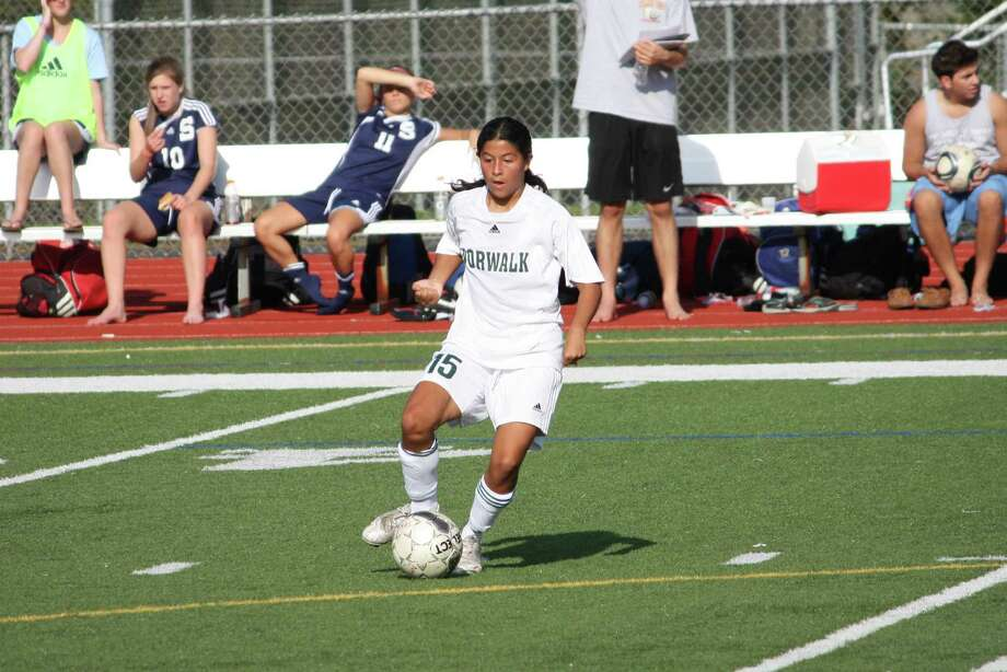 Norwalk High's Kathleen Machado dribbles the ball in a 5-1 loss to Staples on Monday. Photo: Carlos Garcia