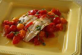 Sole with white wine and tomatoes as seen in San Francisco, California, on Wednesday, September 12, 2012. Food styled by Amanda Gold.
