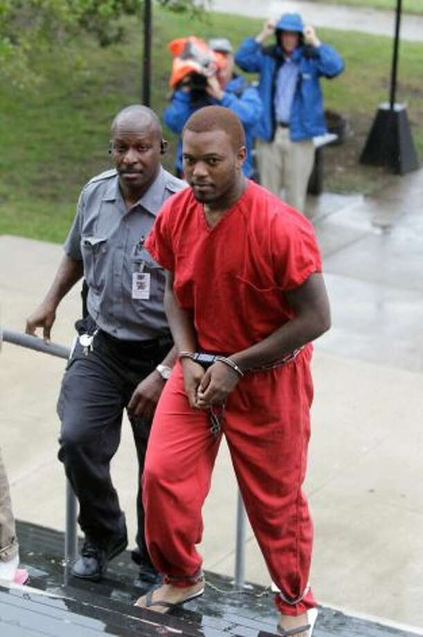 Eric McGowen is escorted into Liberty County Courthouse for sentencing Sept. 13, 2012. He was convicted in the repeated group sexual assault of an 11-year-old girl. Photo: Melissa Phillip, Houston Chronicle /  2012 Houston Chronicle