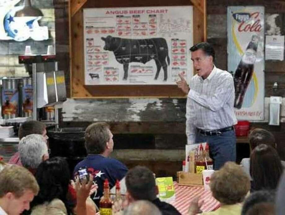 Mitt Romney speaks at a popular BBQ joint in Arlington. (AP)