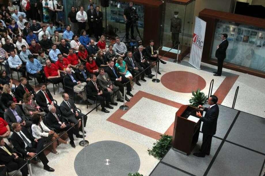 Mitt Romney speaks at USAA in San Antonio on June 6, 2012.